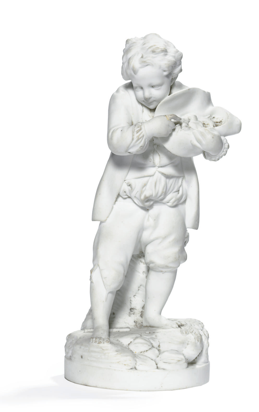 A NIDERVILLER BISCUIT FIGURE OF A PEASANT BOY WITH A BIRD'S NEST IN HIS HAT