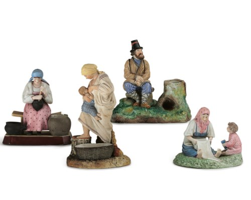 A Porcelain Group of a Woman N