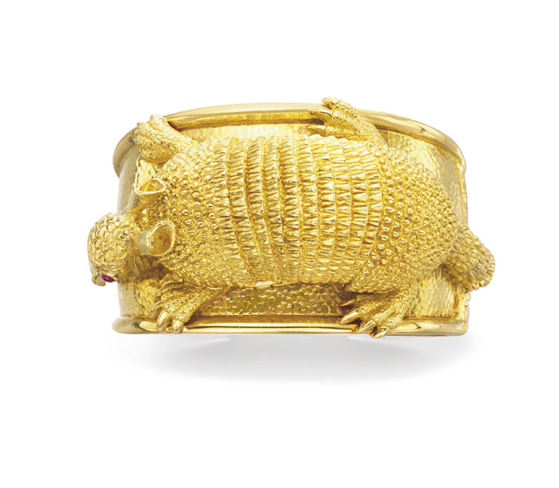 A GOLD AND RUBY BRACELET, BY D