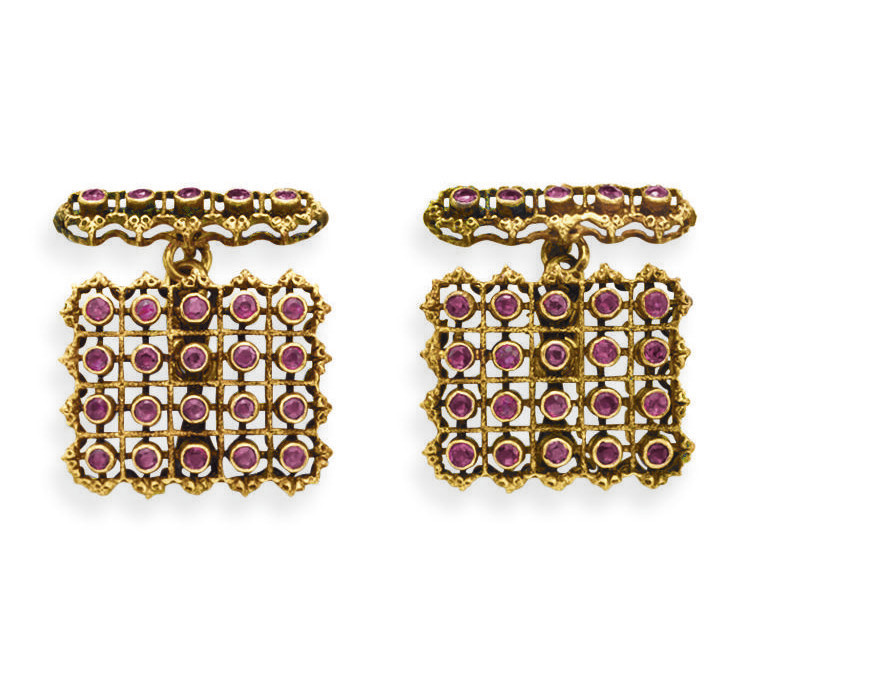 A PAIR OF RUBY AND GOLD CUFFLI