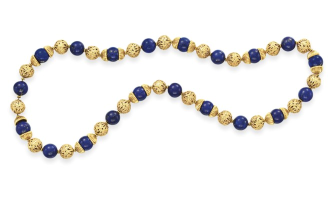 A LAPIS LAZULI AND GOLD BEAD N