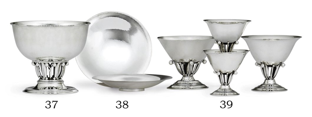 A SUITE OF FOUR DANISH SILVER