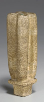 AN EGYPTIAN ALABASTER VESSEL