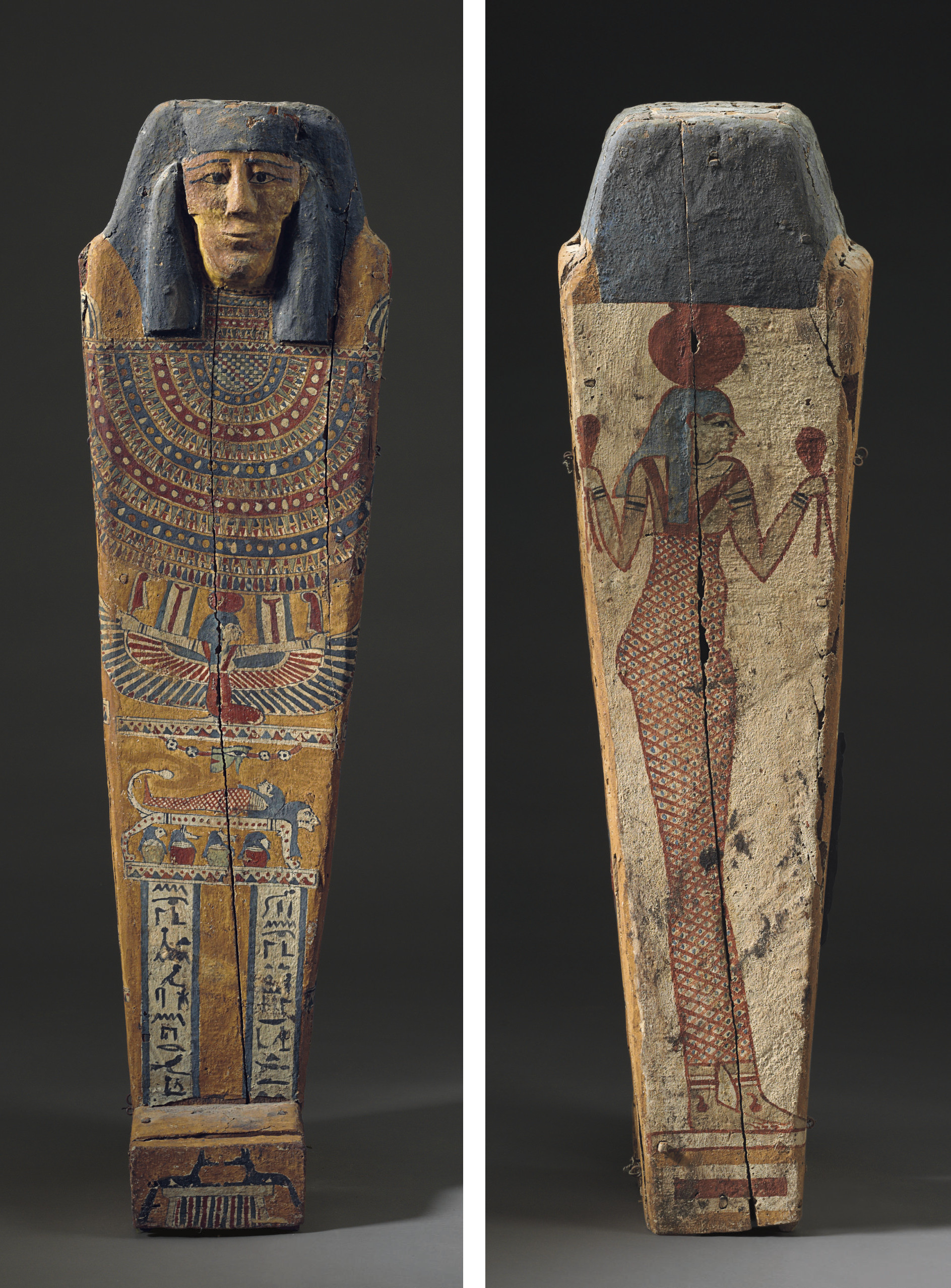 AN EGYPTIAN PAINTED WOOD CHILD