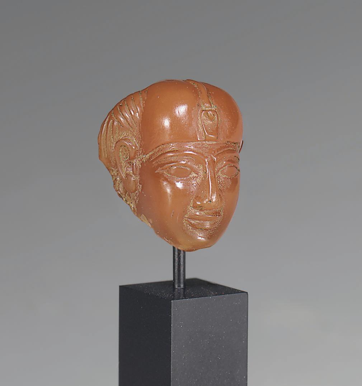 AN EGYPTIAN CARNELIAN HEAD OF