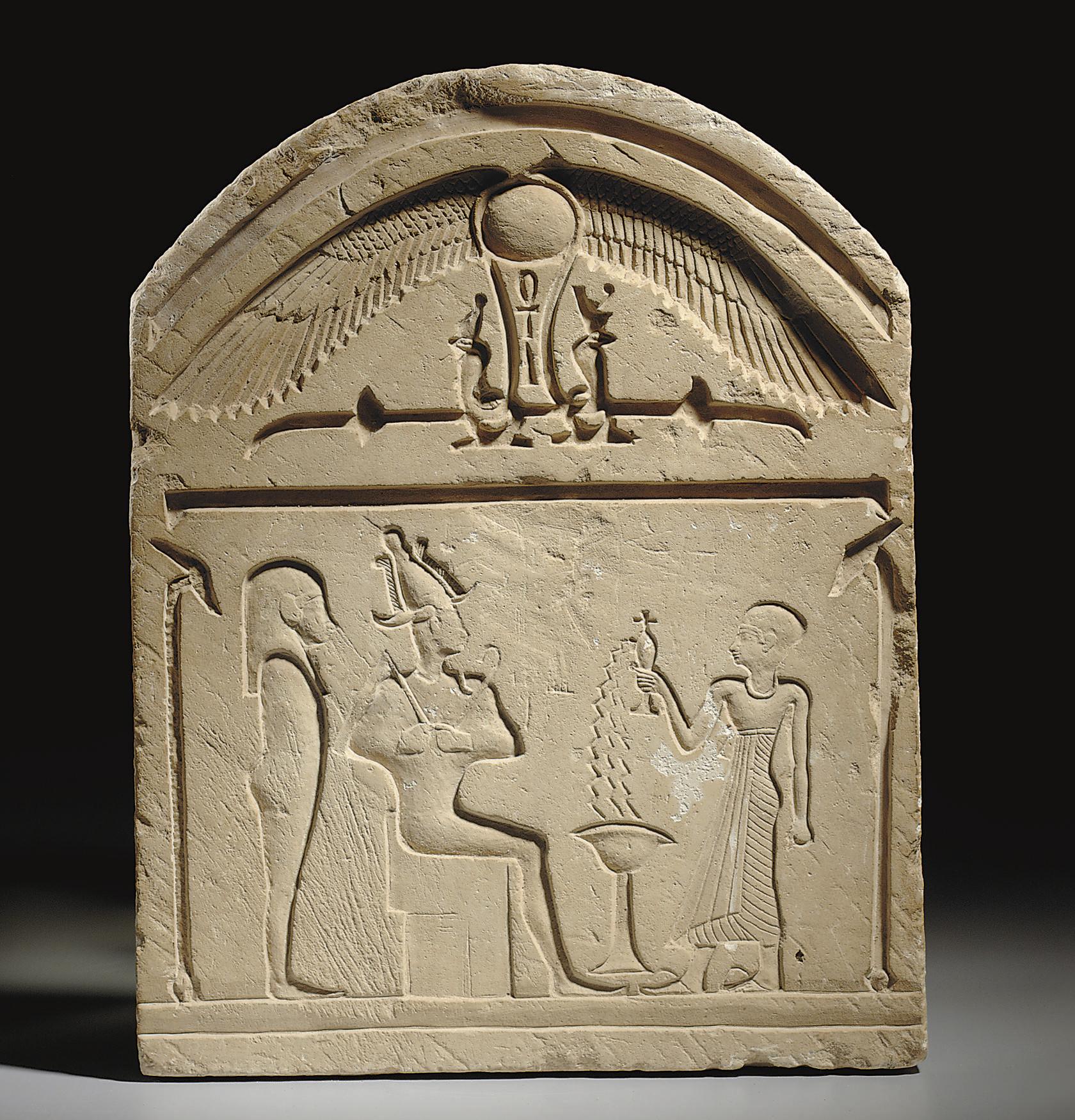 AN EGYPTIAN LIMESTONE ROUND-TO