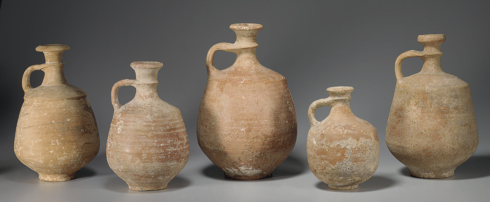 TWENTY ANCIENT POTTERY ITEMS