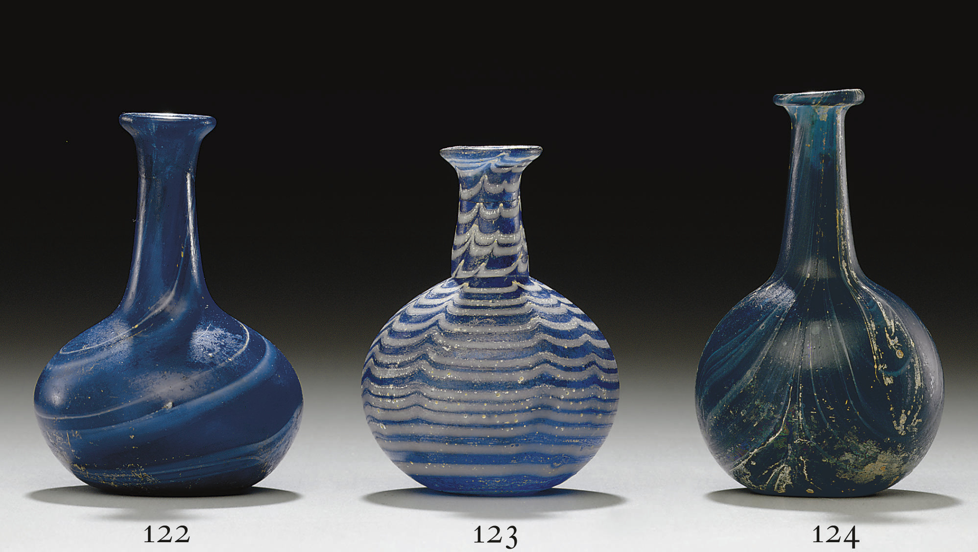 A ROMAN MARBLED GLASS BOTTLE