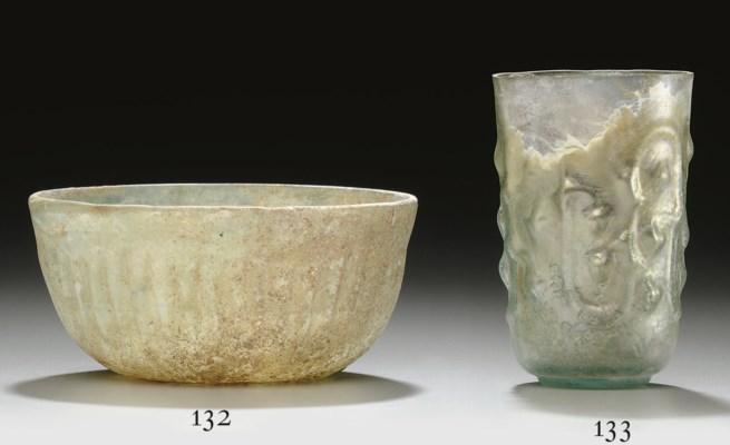 A ROMAN GLASS RIBBED BOWL