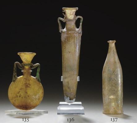 A ROMAN GLASS AMPHORA