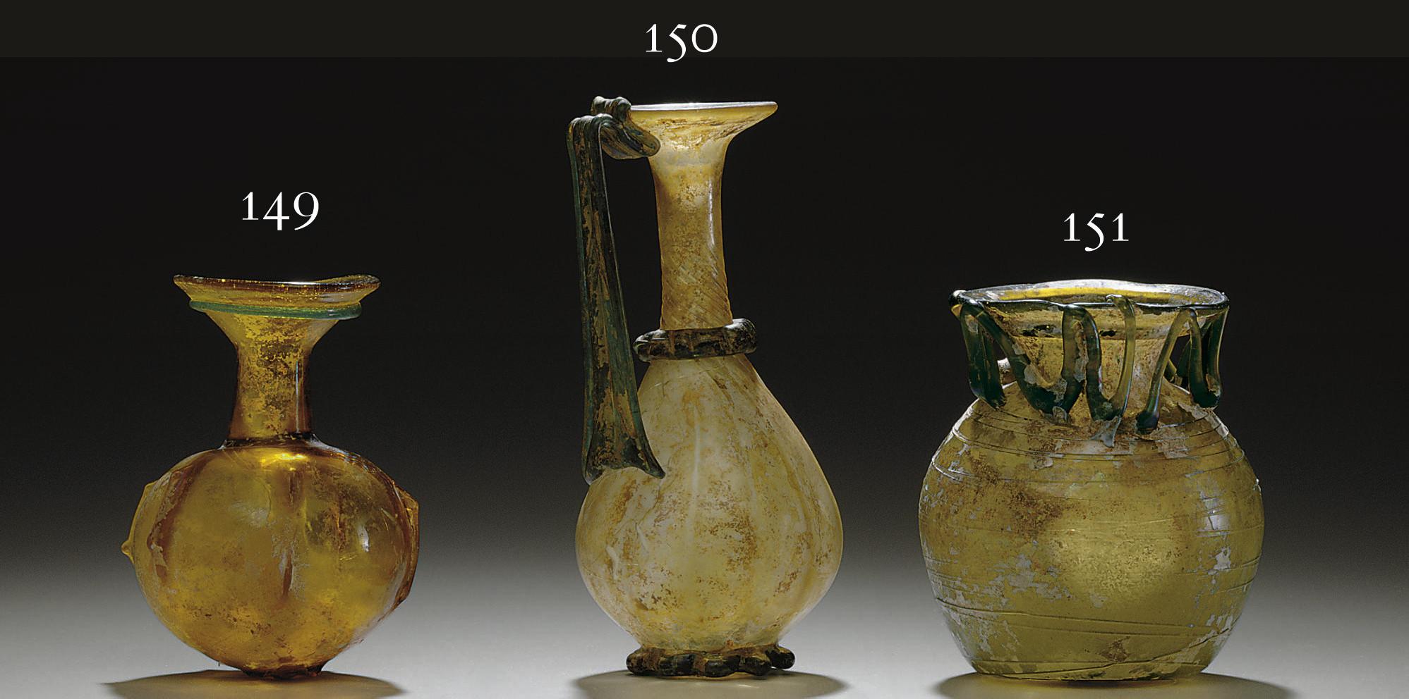 A ROMAN GLASS POMEGRANATE-SHAP