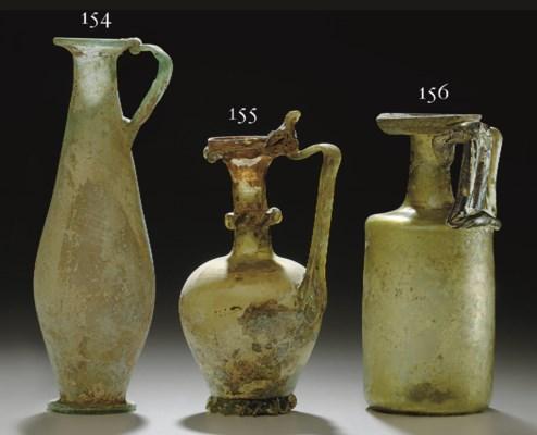 A ROMAN GLASS JUG