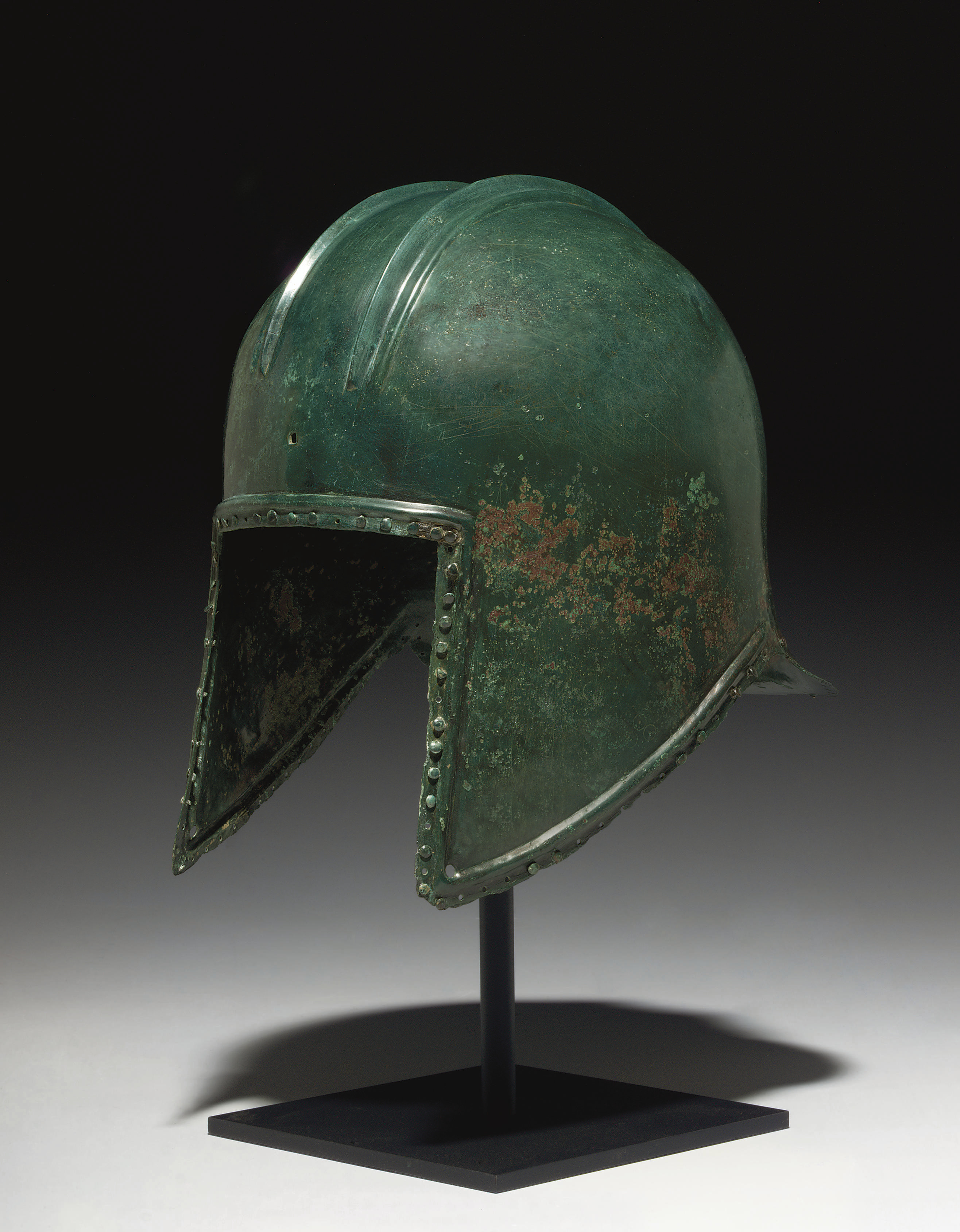 A GREEK BRONZE HELMET OF ILLYR