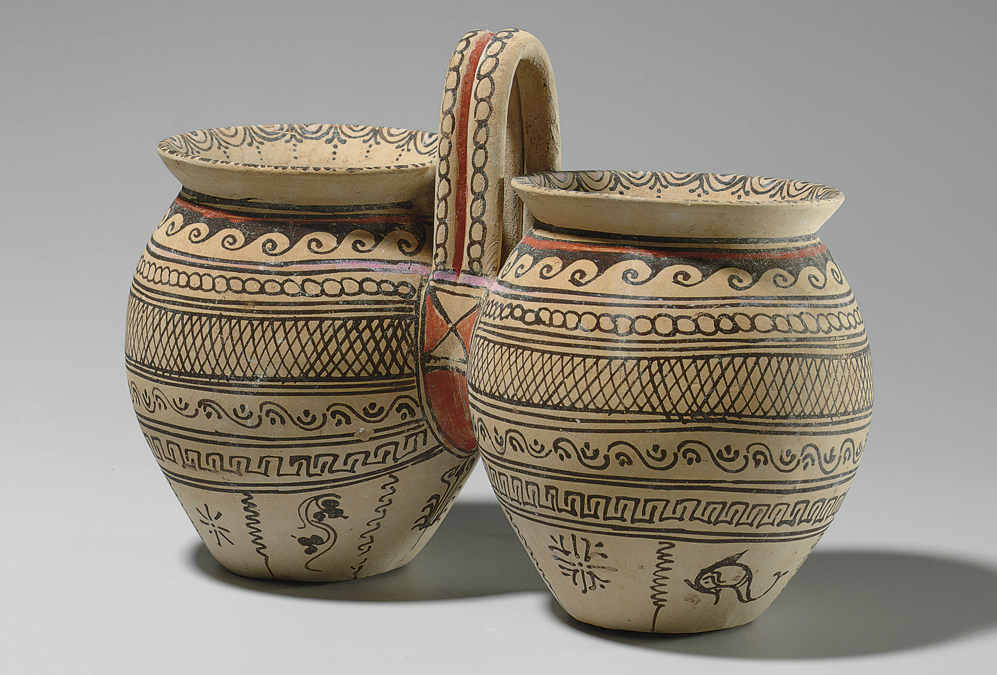 A DAUNIAN POTTERY DOUBLE SITUL