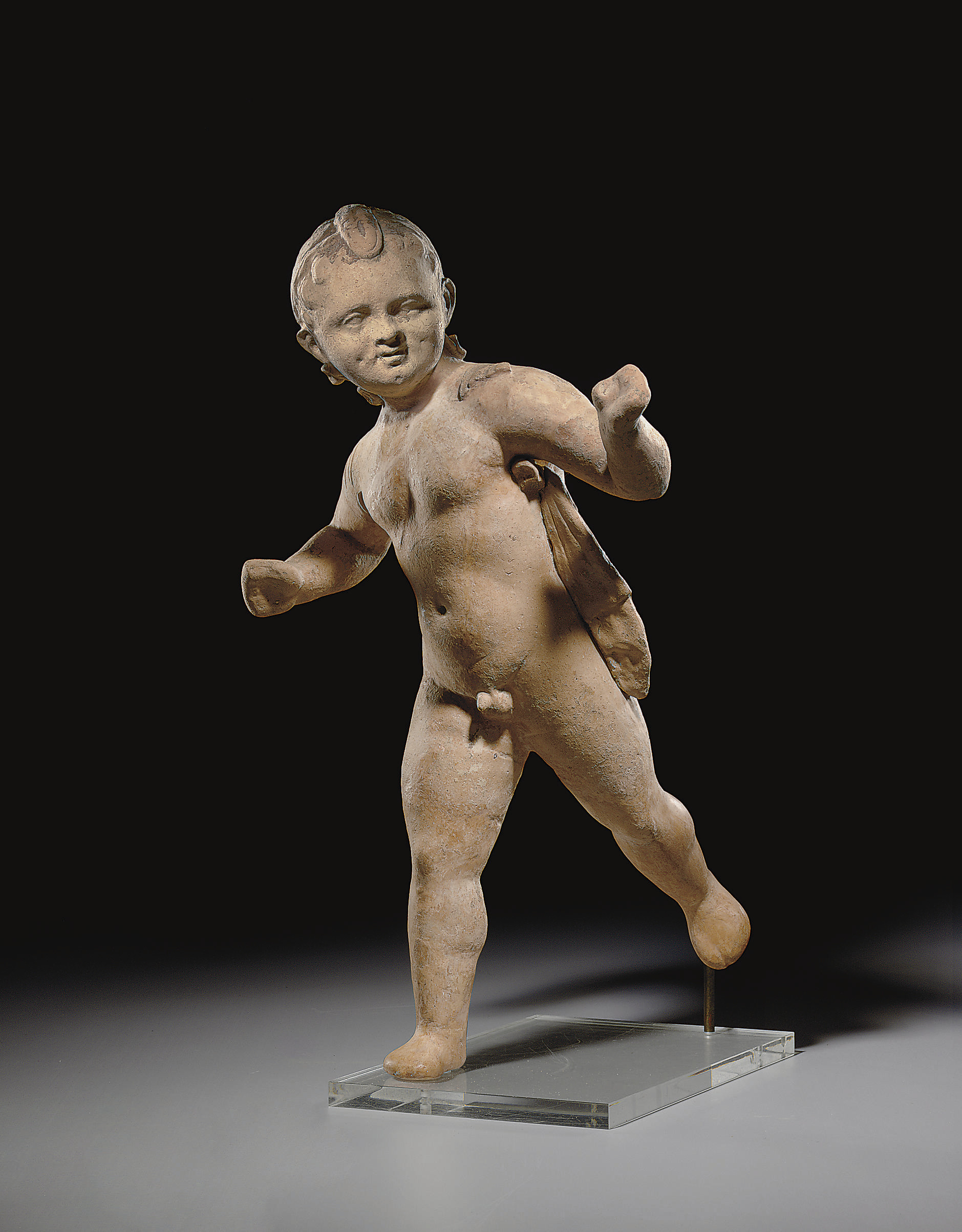 A GREEK TERRACOTTA EROS