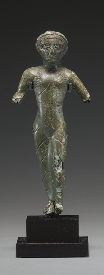 AN ETRUSCAN BRONZE FEMALE VOTI