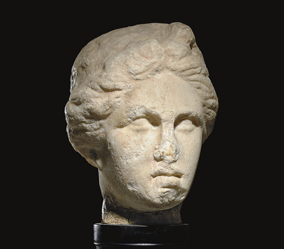 A ROMAN MARBLE HEAD OF A GODDE