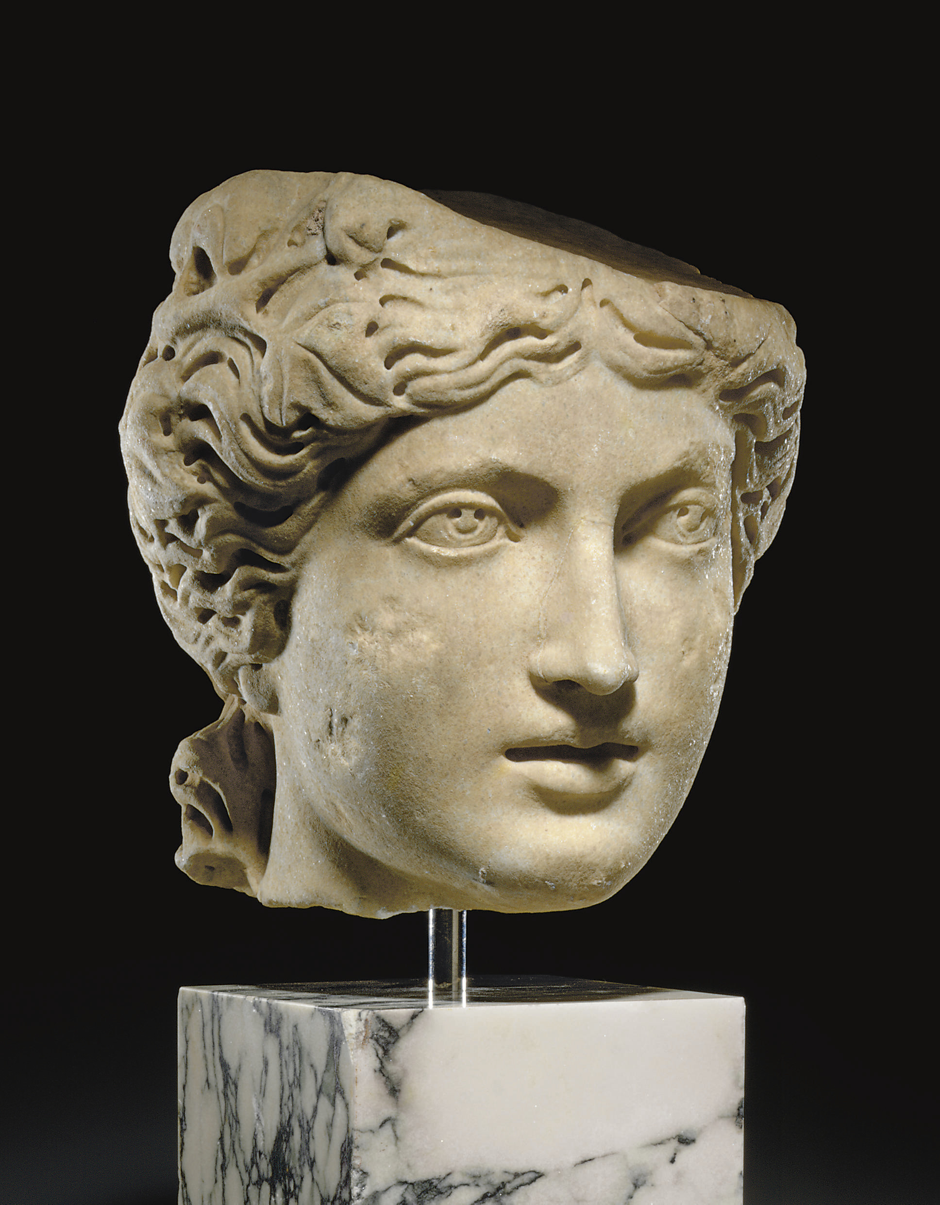 A ROMAN MARBLE HEAD OF A MAENA