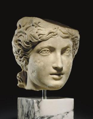 A ROMAN MARBLE HEAD OF A MAENA