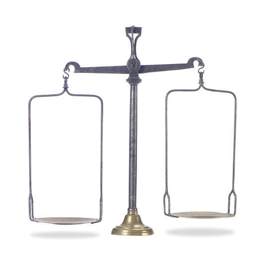 A STEEL AND BRASS SCALE,