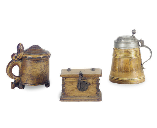 TWO CONTINETNAL WOOD TANKARDS,