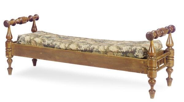 A TURNED WALNUT LOW BENCH,