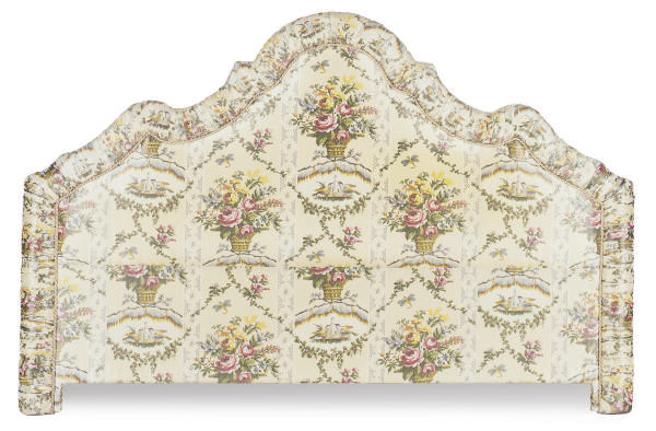 A SILK FLORAL UPHOLSTERED HEAD
