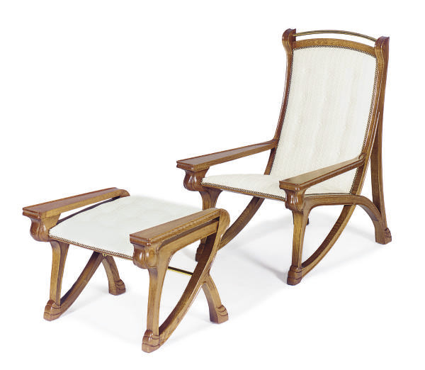 AN OAK PLANTATION ARMCHAIR AND