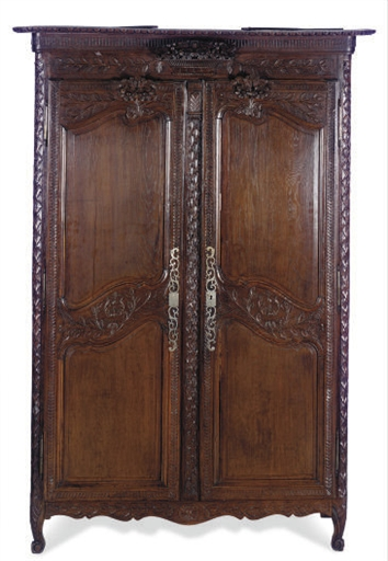 A FRENCH STAINED OAK ARMOIRE,