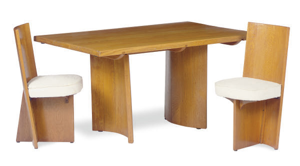 AN OAK DINING TABLE AND EIGHT