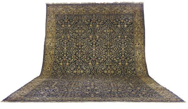 A PERSIAN STYLE CARPET,