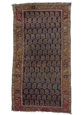 A NORTHWEST PERSIAN CARPET AND