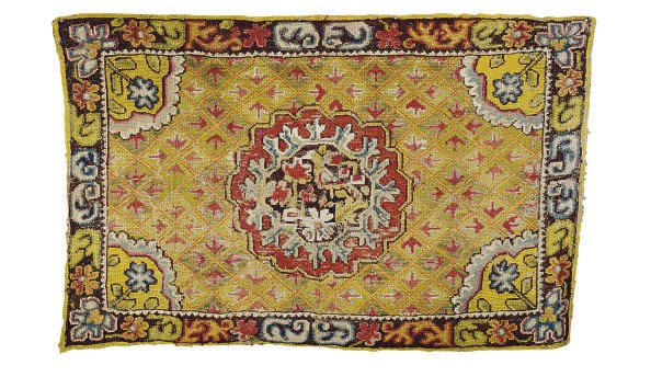 A CONTINENTAL NEEDLEWORK RUG,
