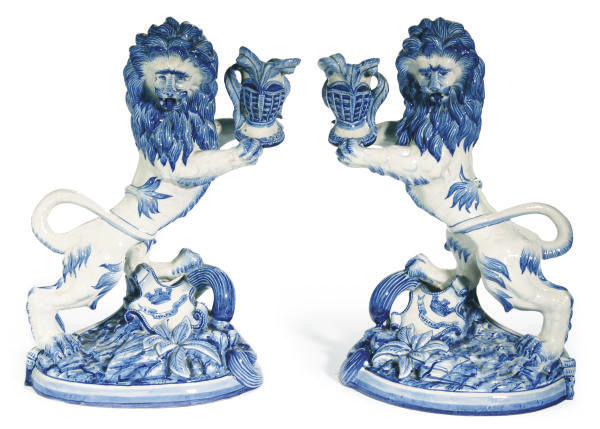 A PAIR OF FRENCH FAIENCE LION-
