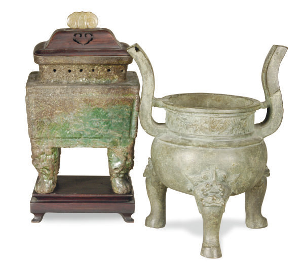 A CHINESE BRONZE TRIPOD CENSER
