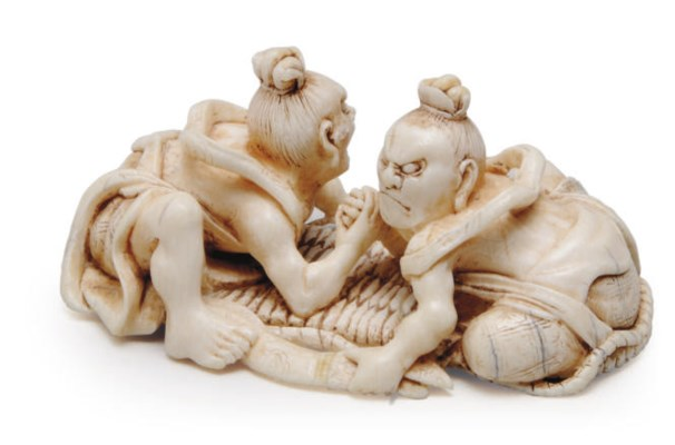 A JAPANESE IVORY MODEL OF TWO