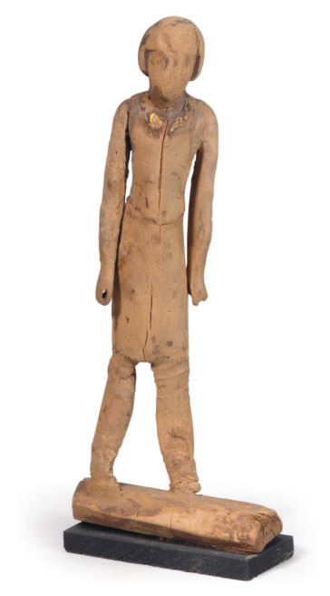 AN EGYPTIAN WOOD FIGURE OF A M