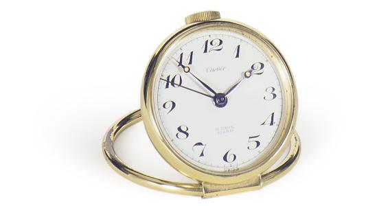 A BRASS DESK CLOCK,