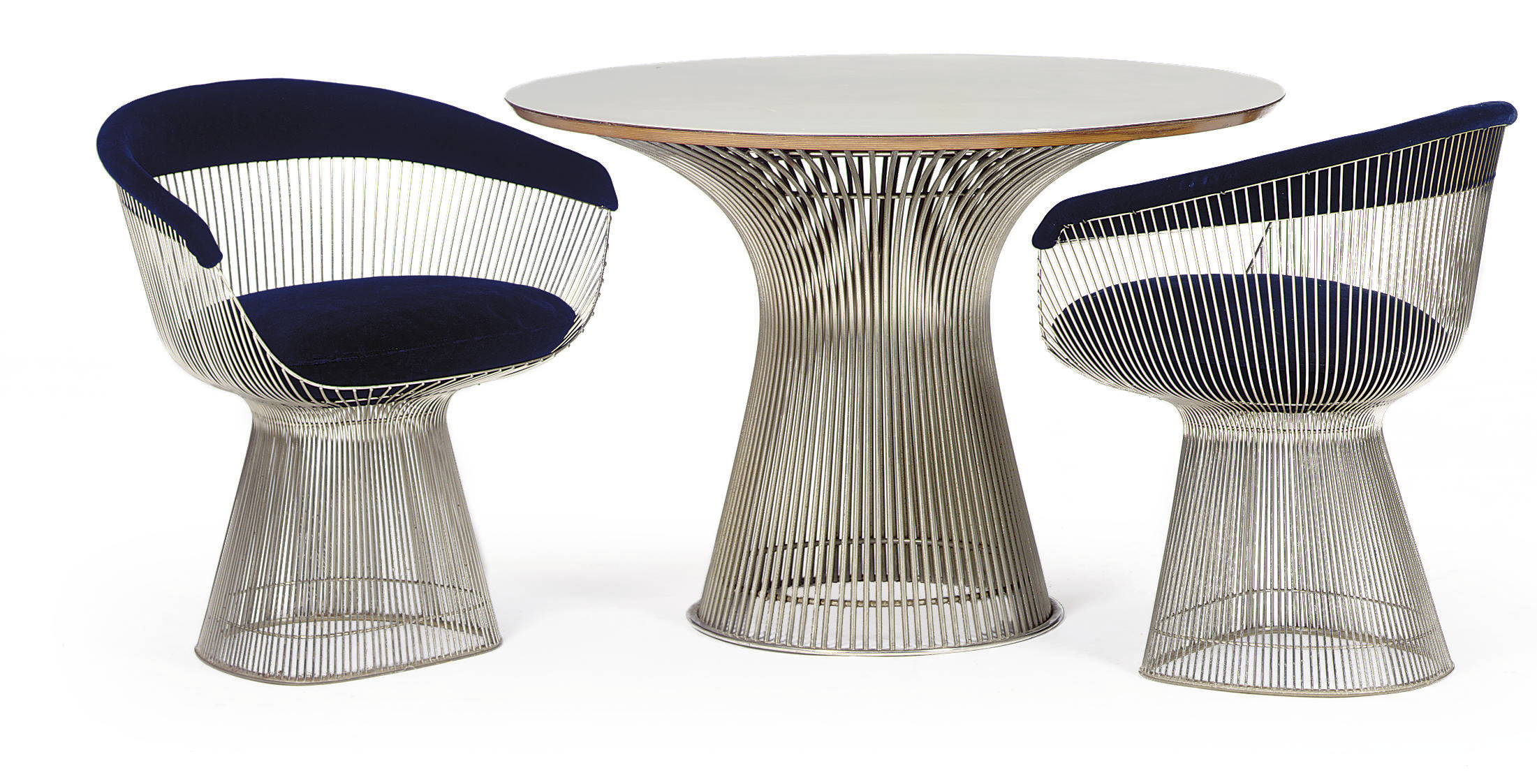 A DINING TABLE AND CHAIRS,
