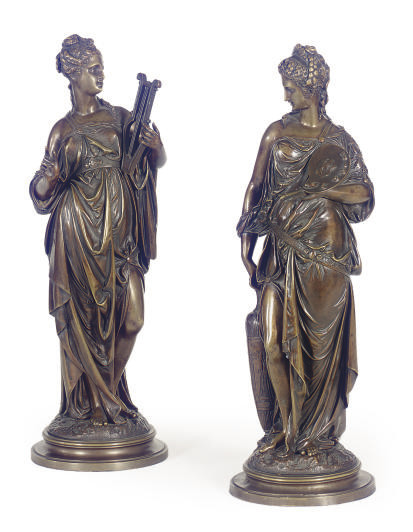 A PAIR OF PATINATED BRONZE ALL