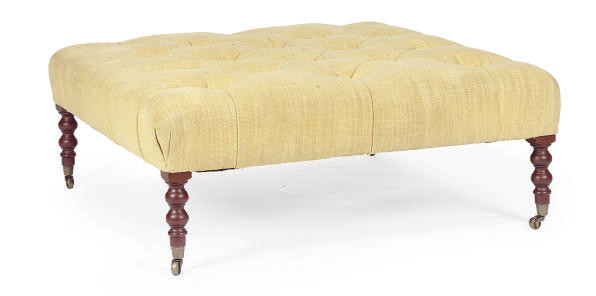 A YELLOW VELOUR BUTTON-TUFTED