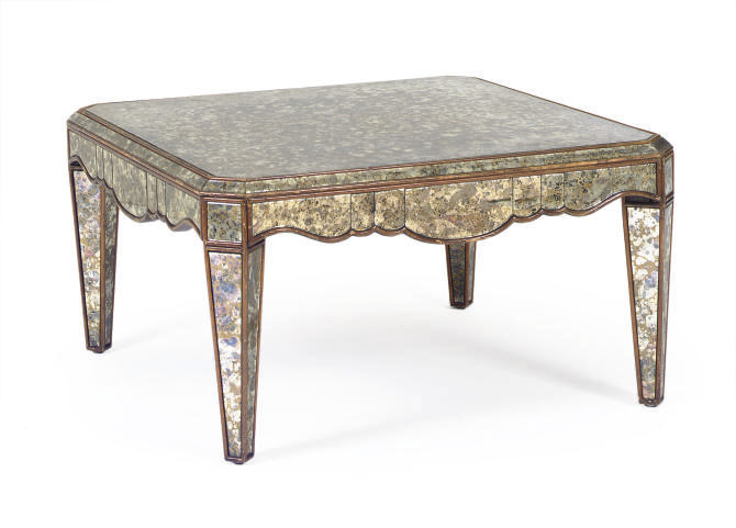 A GILT-DECORATED AND MIRRORED