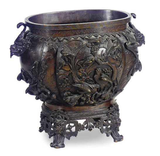 A CHINESE PATINATED BRONZE JAR