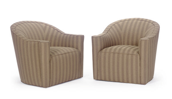 A SET OF FOUR UPHOLSTERED SWIV