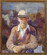 Portrait of a seated boy wearing a baseball cap
