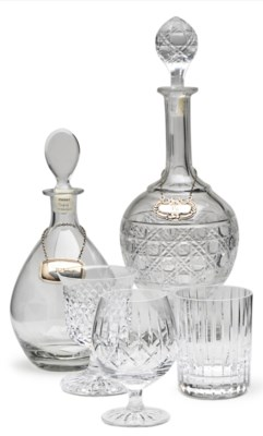 A GROUP OF CUT-GLASS DECANTERS
