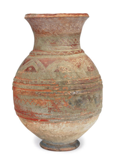 A POTTERY LARGE JAR INCISED OV