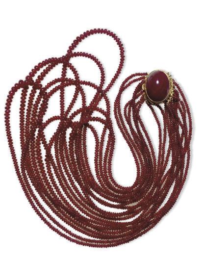 A MULTI-STRAND RUBY BEAD NECKL
