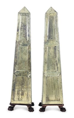A PAIR OF EBONIZED AND MIRRORE
