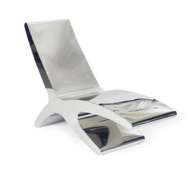 A STAINLESS STEEL CHAISE LONGU